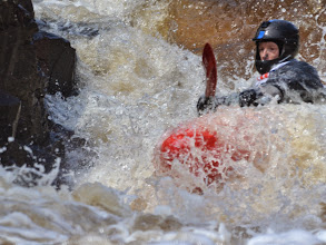 Photo: Kayaker Joel Decker of Carlton, Minn., makes his way down the rapid called Naked Man in the first heat of the Lester River Race.