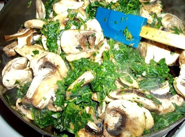 Heat the olive oil in a large skillet, then add the spinach, mushrooms and...