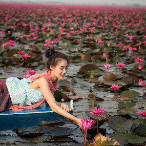 Portrait of a beautiful women on boat in lotus garden at by Visoot Uthairam - People Portraits of Women ( plant, person, leaf, beauty, asain, botanical, people, blossom, hat, farm, lotus, waterlily, life, farmer, nature, pool, hands, woman, lifestyle, toil, asia, worker, pond, flower, work, water, botany.agriculture, park, hold, horticulture, thorn, agriculture, bloom, lake, women, rural, gardener, lily, female, outdoor, floating, lady, gardening, active, glove, garden, natural, outside, apron )