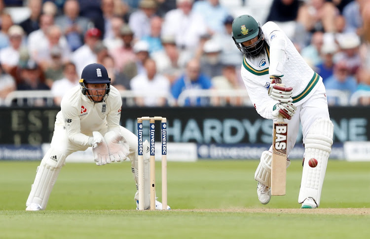 South Africa's Hashim Amla hits a six.