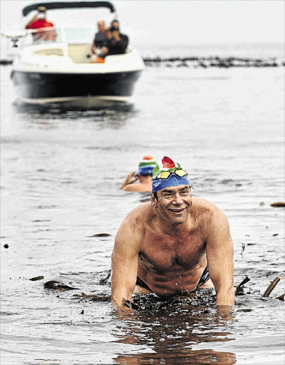 Theodore Yach, who died last year, completes his 100th Robben Island crossing.