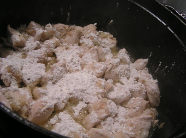 Sprinkle the top of the chicken with the flour; stir for 1 minute, thoroughly...