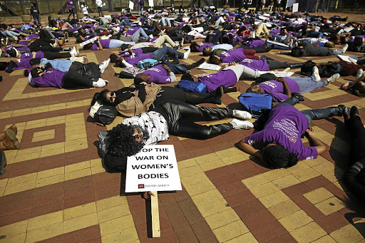 Wits students hold a silent protest against rape in this file picture last year. Activists say police must not only be judged on reducing rape, but also on the way they treat victims. /ALON SKUY