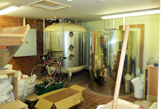 Photo: from the left, grist hopper, malts, control board, brewer's bike, well insulated hot liquor tank, cold liquor tank, laboratory