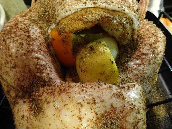 Sprinkle 1/2 seasoning mixture inside turkey along with bayleaves, onion, lemon, and orange wedges....