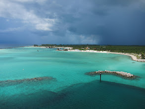 Photo: Castaway Cay from our room balcony, BIG lightning storm on the horizon