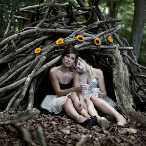 The den in the woods by Antony Sendall - People Fashion ( fashion, dreamy, location, sunflowers, forest, beauty, woods, glamour, fantasy, blonde and brunette, sisters, bivouac, cocktail dresses, den, female models )