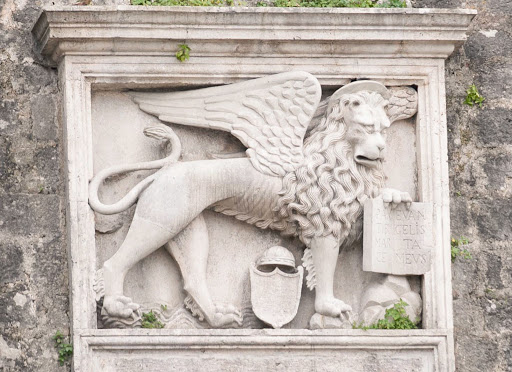 Kotor-emblem.jpg - A winged lion-like statue on the city walls of Kotor, Montenegro.