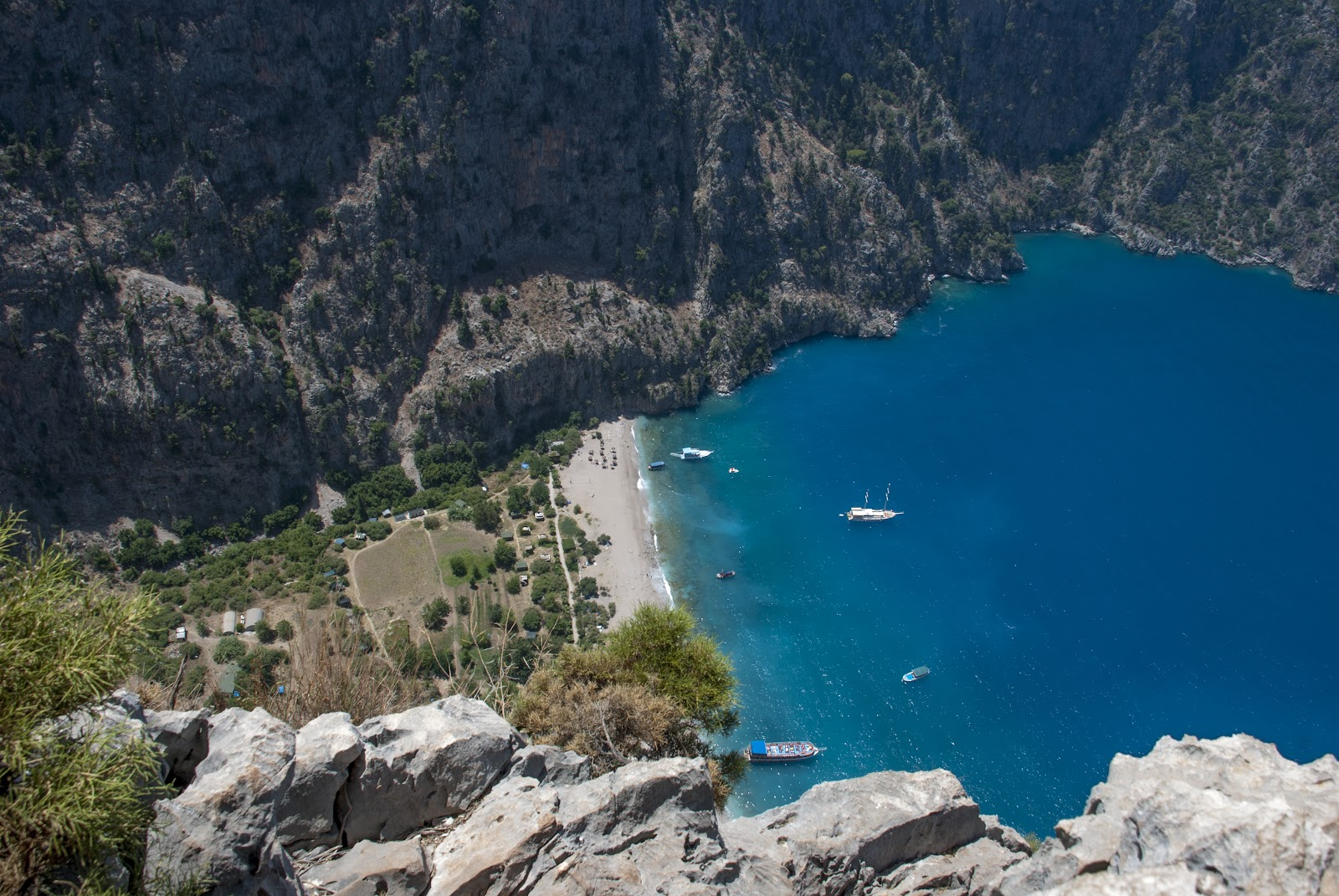 kelebekler vadisi butterfly valley turkey aerial view secluded sandy beach boats turquoise sea turkey riviera
