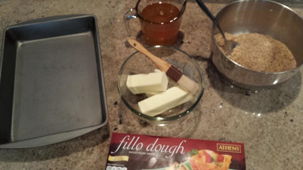 Set the oven to 350 degrees.  Lightly grease 9x13 pan.Process the nuts into...