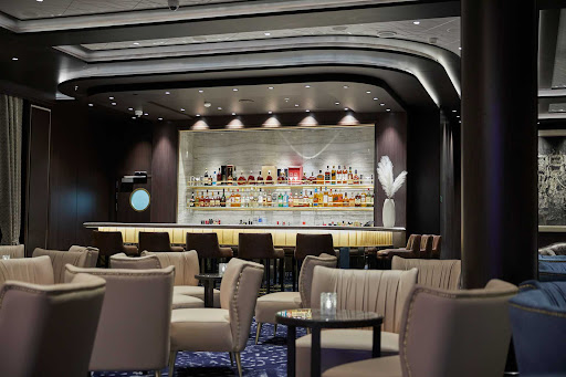 Relax with a cocktail at the main lounge aboard Seven Seas Splendor.