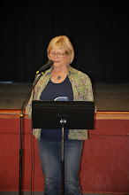 Photo: Carol McCarthy reading Jack McCarthy's poem.