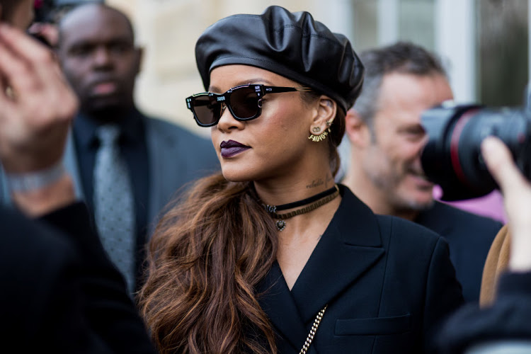 Rihanna donned a Dior beret to Dior's A/W 2017/18 fashion show in Paris.
