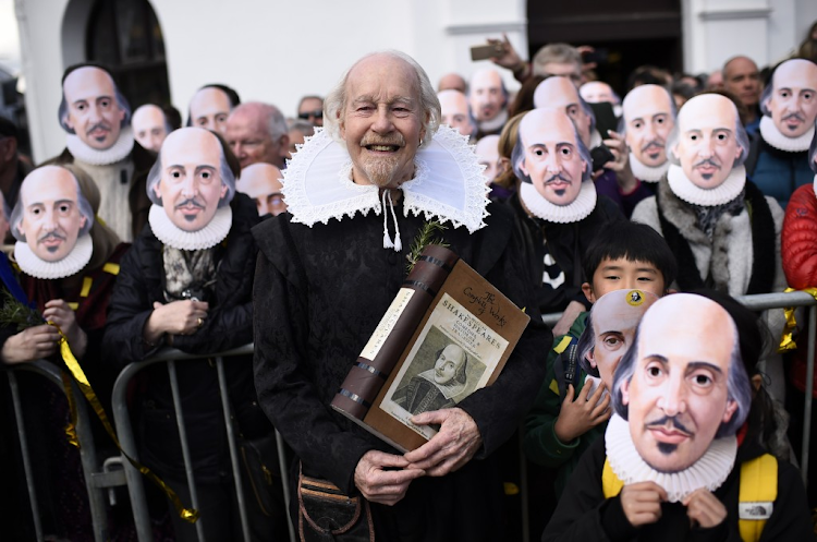 "PEOPLE put on their masks of William Shakespeare during the ""Mask Moment"", which is a celebration marking the 400th anniversary of Shakespeare's death on April 23 in Stratford-upon-Avon, England. The Mask Moment is one of several events that will be celebrating his works in the UK, during the course of the year. Picture: REUTERS"