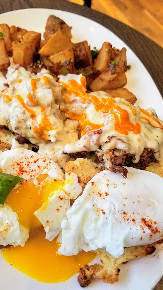 Headwaters Brunch - Biscuits and Gravy with buttermilk fried chicken and poached eggs