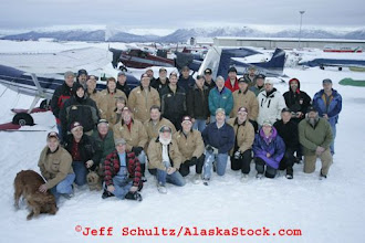 "Photo: Saturday February 17th 2007 At Merrill field in Anchorage, A potion of the ""Iditarod Air Force"" Volunteer bush pilots and helpers gather for a group photo prior to a day of flying straw and musher supplies to checkpoints along the race."