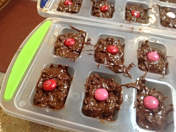 Divide the chocolate mixture evenly among the 24 molds using a medium size spoon....