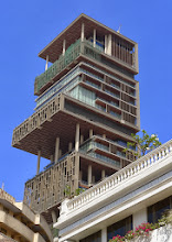 Photo: Antilia, the world's most expensive house at $1 billion.  1 family (Mukesh Ambani of Reliance Industries). 27 floors, 40,000 sqft of land, 570 feet tall, 400,000 sqft of interior space.  6 stories for car parking alone, to park 168 car collection. Inside the house you will find nine elevators with lot of lounge and personal gym in each floor. Served by 600 servants.http://en.wikipedia.org/wiki/Antilia_(building) http://mostexpensivehouses.org/