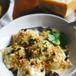 Curry-Roasted Butternut Squash Ravioli with Champagne Cream Sauce, Currants and Almond-Parmesan Breadcrumbs
