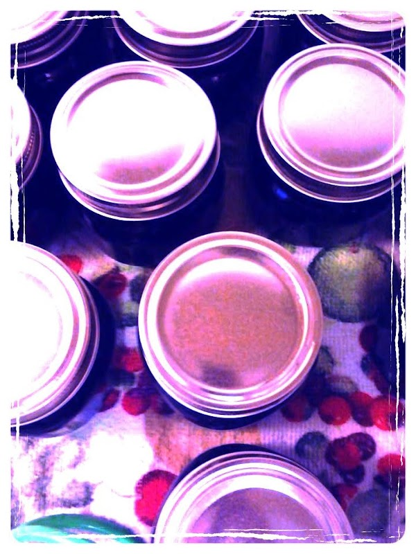 Remove jars from canner to a towel lined surface.  Let sit and cool...