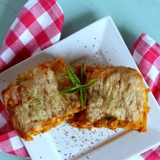Crab & Kale Lasagna Rolls with Creamy Herb Pumpkin Sauce