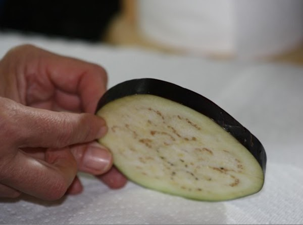 Slice eggplant into 1/2 inch slices. Salt and let weep. In saucepan, melt butter....