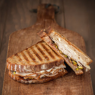 Turkey & Goat Cheese Panini with Fig Jam & Crushed Pistachios.