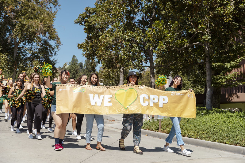 """students holding banner that reads: """"We heart CPP"""""""