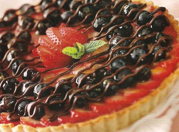 Two Berry Tart With Chocolate Drizzle