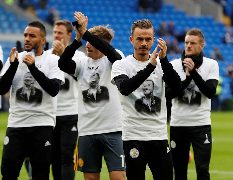 Leicester City players wearing shirts depicting Vichai Srivaddhanaprabha, late chairman of Leicester City Football Club, during the warm up before the match.