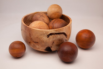 "Photo: STAN WELLBORN – 8"" x 8"" Bowl filled with 5"" Balls [BOWL – Maple Burl  BALLS –  Sycamore, Dogwood, Walnut, Cherry, Oak, Black Locust, Maple]"