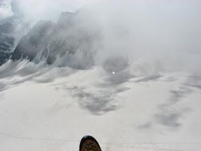 Photo: Décollage dans la trouée entre deux nuages