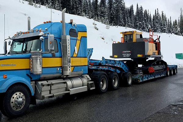 7 axle semi truck hauling heavy machinery