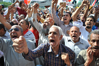 Photo: Cheers erupt in the middle of Tahrir Square.