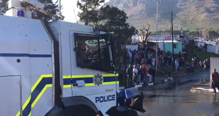 The city council and the police had sent water cannons to the area in a bid to defuse protests.