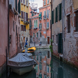 After the Cruise Ships Leave by Gary Stanley - Buildings & Architecture Public & Historical ( mirror, water, narrow, reflection, venice, motoboat, italy, canal )