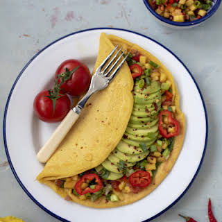 Chickpea Omelette with Avocado and Mango Salsa.