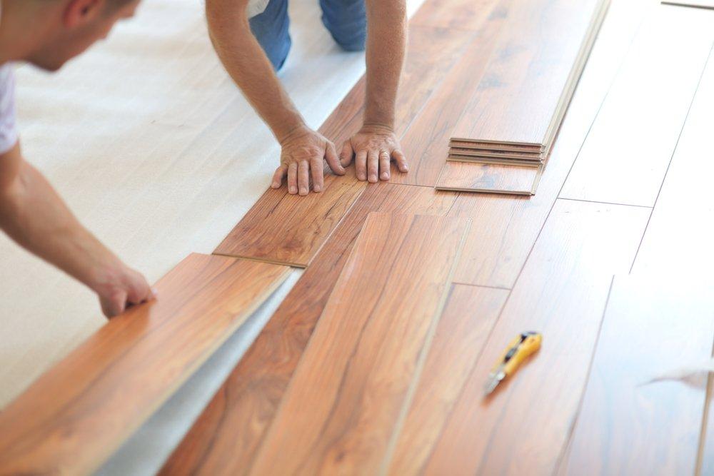 Installing laminate flooring in new custom home indoor
