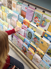 Photo: After leaving the Sears Outlet center, we headed over to the greeting cards. We needed to buy a couple cards for some of my nephews. We are picking up the least expensive cards, which are .99 cents.