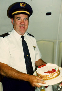 Stan in 1989 holding his retirement cake