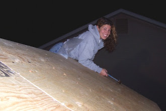 Photo: My dad grabbed my camera to take this picture of me while I was nailing down the plywood roof board. The plywood will strengthen the roof and allow me to add shingles without penetrating the cedar roof board with the shingling nails.
