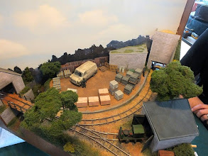 "Photo: 001 An overhead view of Michael Campbell's little 014 industrial layout Thakeham Tiles. Skip wagons are propelled into the bay at the top of the picture where they are loaded with a clever magnetic ""tool"" that Michael has designed. They are then taken to the unloading shed bottom left where the skips tip the magnetised load into a tray below so that the process can be repeated ."