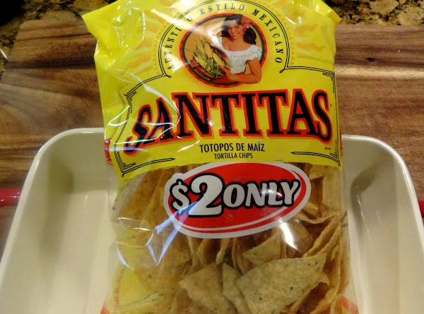 PREPARE THE CHIPS, BEANS AND CHEESESYou will need a medium size bag of Santitas...