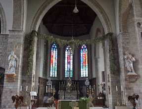 Photo: Church with hops strung across the alter in Poperinge