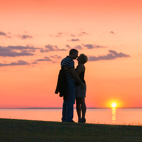 by Adrian Campfield - Landscapes Sunsets & Sunrises ( shore, lovers, scarlet, reflections, beach, yellow, landscape, romance, coast, curves, kiss, england, sky, serenity, dark, pink, gold, light, sun:, black, skyscape, clouds, water, orange, uk, kissing, valentines, mood, white, romantic, atmosphere, sea, scenic, shadows, red, serene, sunset, amber )