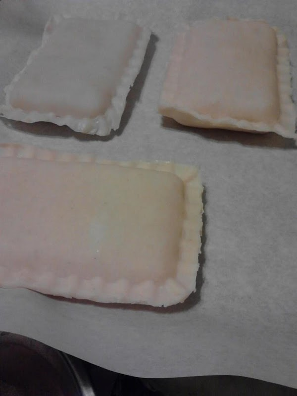 Three filled hand pies on parchment paper