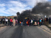 Protesters in Fleurhof in south of Johannesburg block the road.