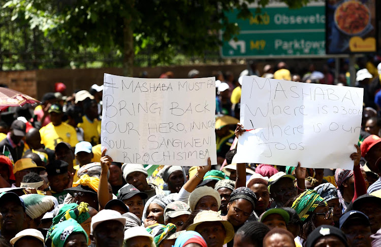 ANC members from greater Johannesburg region show their placards during a march to the offices of Mayor Herman Mashaba and Eskom to handover memorandums demanding better service delivery on October 5 2018