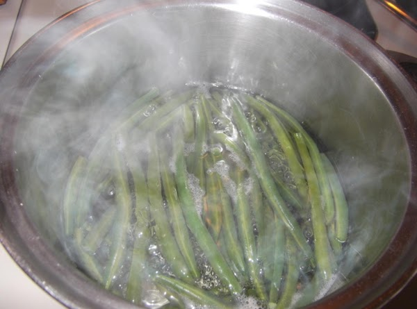 Cut very tips off of fresh green beans.  (**You can cut beans in...