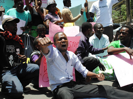 A group of Civil Societies demonstrate outside Deputy President William Ruto's office against the lifting of the ban on GMOs on September 17, 2015. University students have threatened to hold demos to have the ban lifted. /PATRICK VIDIJA